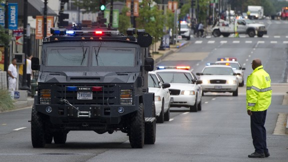Police vehicles move toward the Navy Yard.