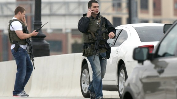 Armed agents from the Bureau of Alcohol, Tobacco, Firearms and Explosives work on the 11th Street Bridge adjacent to the Washington Navy Yard.