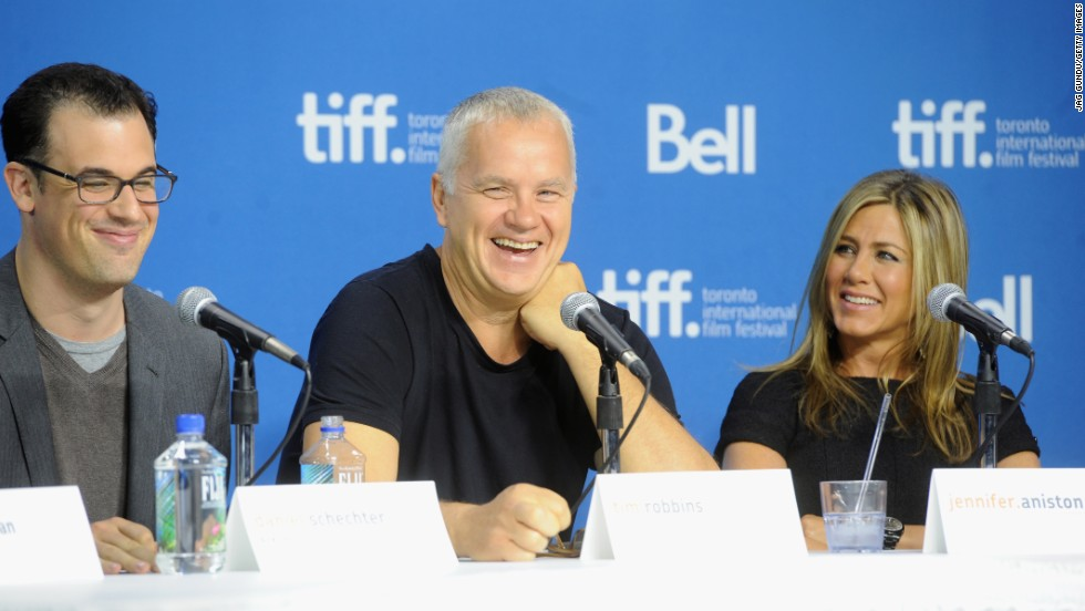"Writer/director Daniel Schechter, left, actor Tim Robbins and actress/producer Jennifer Aniston speak at the ""Life of Crime"" news conference on September 14."