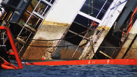 A water line marks the former level of the stricken Costa Concordia as the salvaging operation continues on September 16. The procedure, known as parbuckling, has never been carried out on a vessel as large as Costa Concordia before.