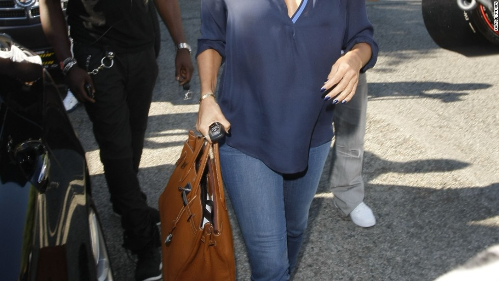 Eva Longoria dodges photographers while stepping out on September 13.