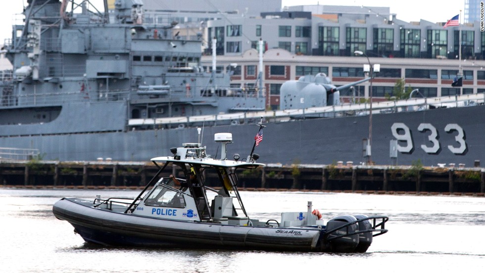 A police boat patrols the waters at the Washington Navy Yard.
