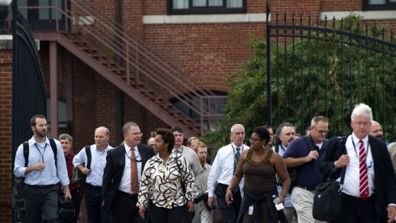 Workers who had been sheltered during a lockdown exit the Navy Yard.