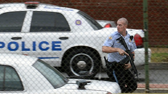 A police officer runs near the scene of the shooting rampage at the Washington Navy Yard on Monday, September 16, 2013. Authorities said at least 12 people -- and the suspect -- were killed in the shooting.