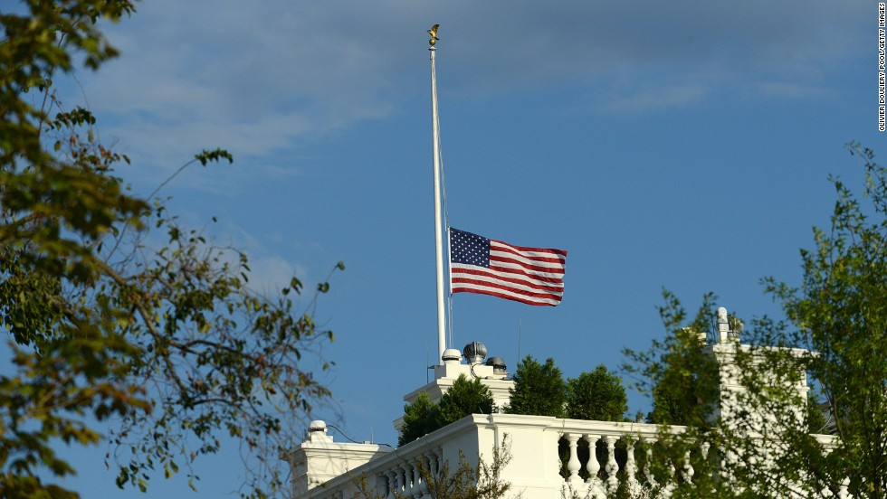 The White House flies the U.S. flag at half-staff following the shooting.