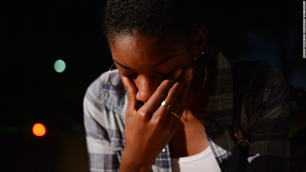 Brittany Carter wipes tears away at the September 16 vigil.