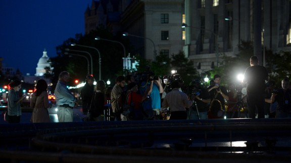 Members of the media cover the vigil on September 16.