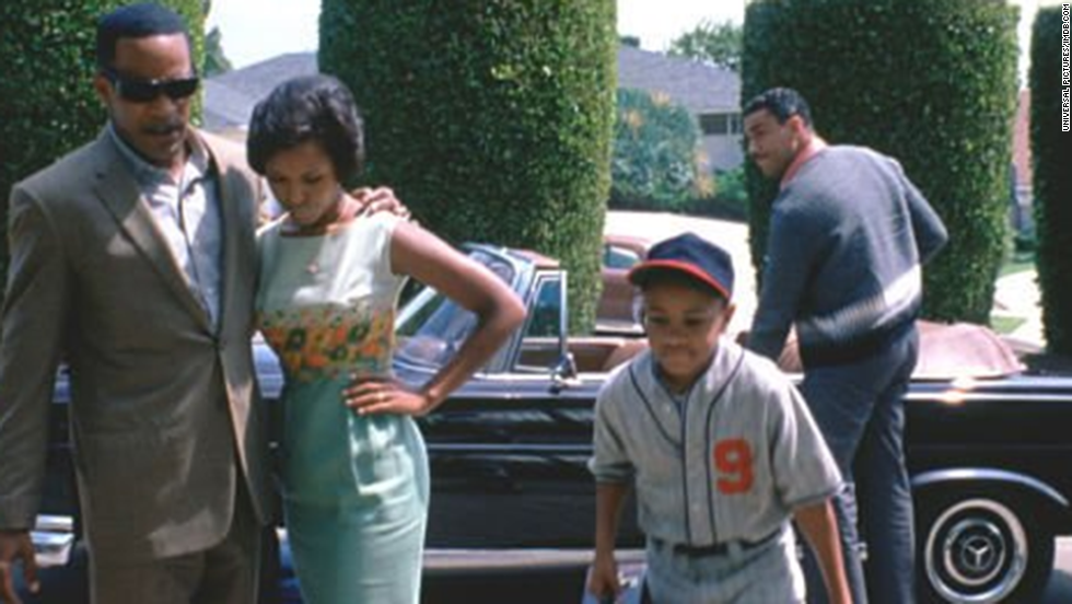 "Washington wins acclaim for her role as Ray Charles' wife in the Oscar-nominated 2004 film ""Ray."" Jamie Foxx received an Academy Award as best actor for his performance in the title role."