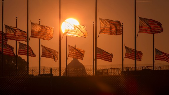 U.S. flags surrounding the Washington Monument fly at half-staff on September 17.