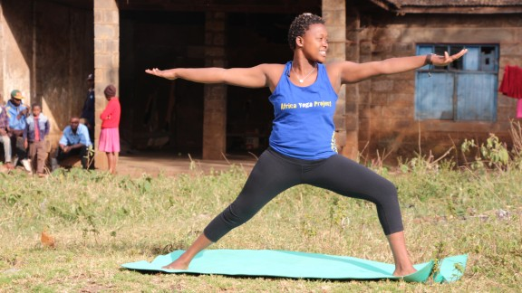 """The Africa Yoga Project has several outreach programs in Kenya's slums, where it teaches orphaned children as well as women living with HIV/AIDS. Margaret Njeri, pictured, gives classes to HIV-positive women. """"Yoga is like a medicine,"""" she says."""