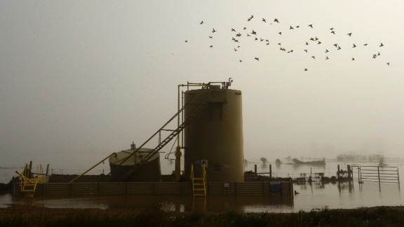 A gas well is surrounded by floodwater near Kersey, Colorado, on September 17.