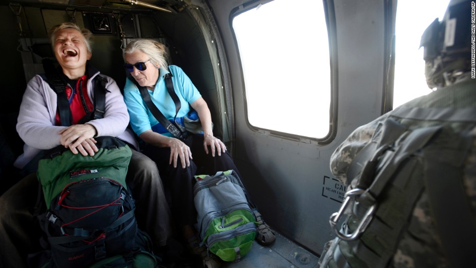 Two women smile and laugh after being rescued by a helicopter crew on September 17 near Jamestown, Colorado.