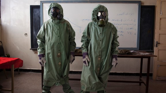 Volunteers wear protective gear to show a class how to respond to a chemical attack in Aleppo, Syria, on September 15. For two months, Mohammad Zayed, an Aleppo University student, has been training a group of 26 civilians to respond to a chemical attack.