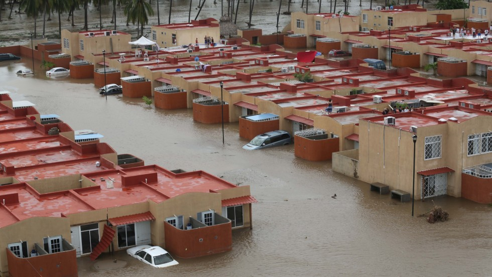 Homes and streets in Acapulco are deep in floodwater on September 17, after the heavy rain brought on by Tropical Storms Ingrid and Manuel.