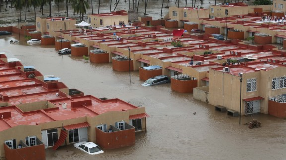 Homes and streets are seen flooded by the heavy rain brought on by tropical storms Ingrid and Manuel are seen on September 17 in Acapulco.