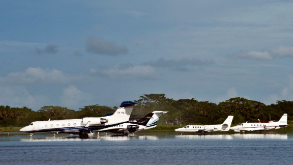 Planes sit on the flooded tarmac of the Acapulco airport on September 17.