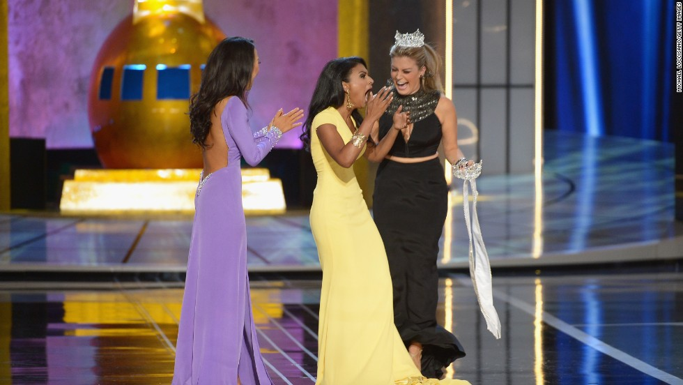 ATLANTIC CITY, NJ - SEPTEMBER 15: Miss America 2014 contestant Miss New York Nina Davuluri (C) is crowned 2014 Miss America by 2013 Miss America Mallory Hagan (R) as Miss California Crystal Lee looks on during the Miss America Competition at Boardwalk Hall Arena on September 15, 2013 in Atlantic City, New Jersey.