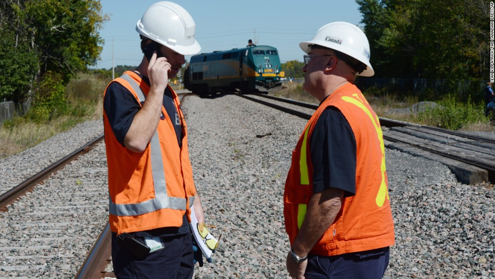 Transportation Safety Board of Canada officials work at the scene on September 18.