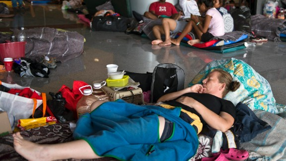 People rest in a shelter in Acapulco on September 17.