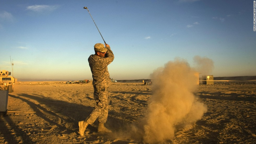 Not all extreme golfing venues are so formal. Here a US Army soldier hits a golf ball at his forward operating base in Paktika province, situated along the Afghan-Pakistan border.
