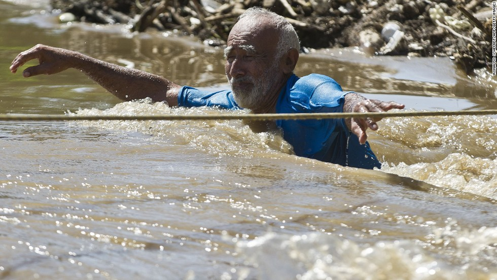 A man wades through floodwaters in Acapulco on September 18.