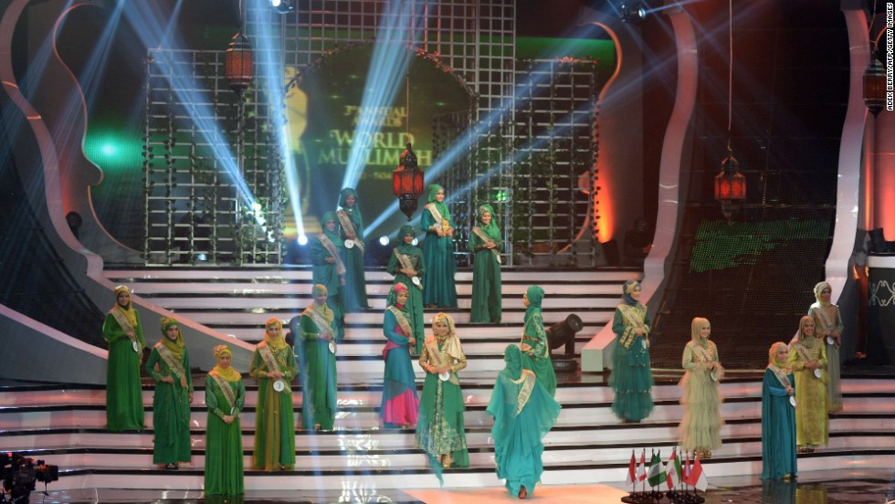 "Contestants in the World Muslimah 2013 competition perform onstage in Jakarta, Indonesia, on Wednesday, September 18. As an answer to the Miss World competition, the annual award was created to crown the woman who applies ""Islamic values in everyday life"" as Miss World Muslimah, according to the <a href=""http://ads2.kompas.com/layer/muslimah/home"" target=""_blank"">World Muslimah website</a>."