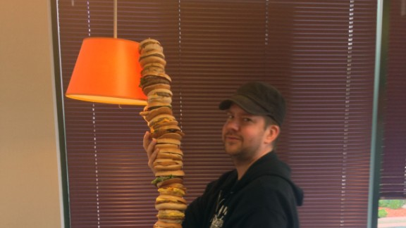 Nick Chipman poses with his McEverything burger.