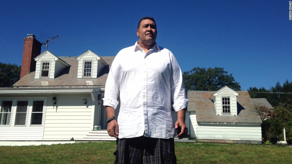 Former NFL offensive lineman Brian Holloway stands in front of his rural vacation home on Wednesday, September 18, in Stephentown, New York. Holloway's rural vacation home was trashed during a Labor Day weekend party attended by about 300 teenagers.