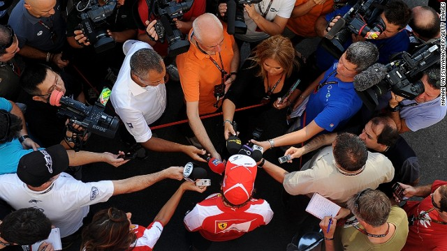 Ferrari driver Fernando Alonso faces the media in Singapore hungry to know what he makes of new team-mate Kimi Raikkonen.