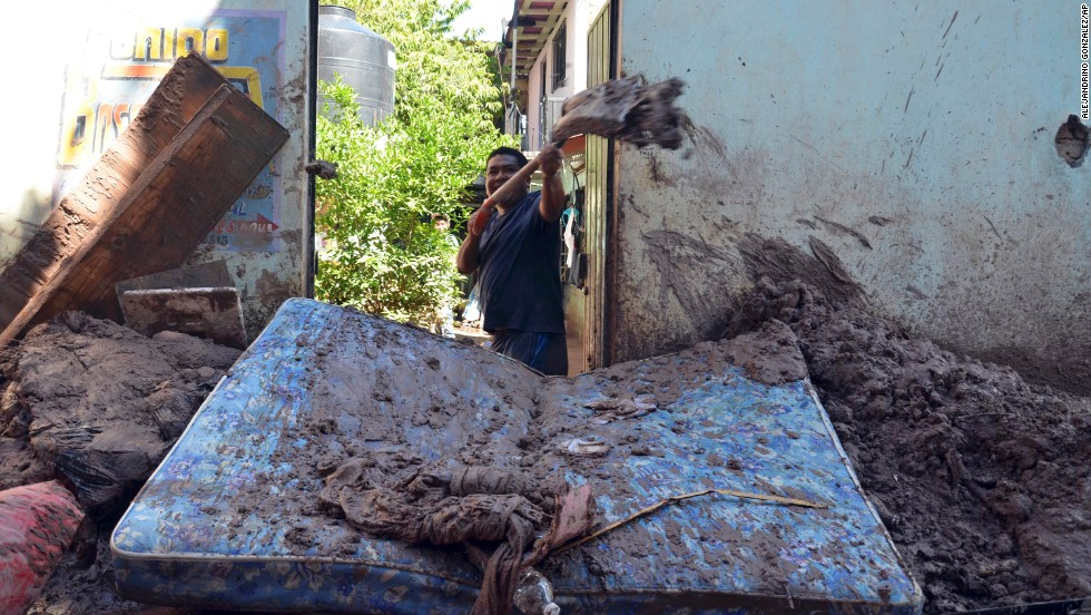A man shovels mud from his home on September 19 in Chilpancingo, Guerrero.