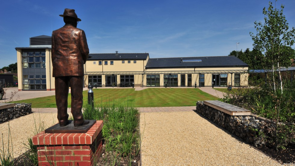 A statue of IJF founder Lord Oaksey surveys the state-of-the-art rehabilitation center that bears his name in Lambourn, England. Opened by Princess Anne in 2009, Oaksey House caters for anyone who has suffered a severe horse-related injury and has five permanent residents.