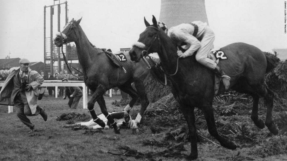 The IJF was founded in 1964 after jockey Paddy Farrell, lying prostrate in this picture, was paralyzed for life after falling at that year's Grand National. With insufficient assistance then available to jockeys in such plight, and with Tim Brookshaw having also suffered paralysis not long before, the Farrell-Brookshaw fund was created - ultimately turning into today's IJF.