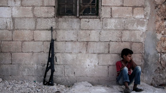 A Syrian child sits in a village in the Idlib province countryside on September 19.