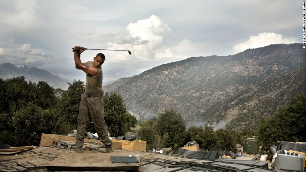 "Before his death in 2011, British-American photographer Tim Hetherington spent time taking pictures of a US contingent of soldiers establishing an outpost in northeastern Afghanistan. Now on display at the <a href=""http://www.openeye.org.uk/main-exhibition/tim-hetherington-you-never-see-them-like-this/"" target=""_blank"">Open Eye gallery in Liverpool,</a> Hetherington's work explores how these soldiers cope with their emotionally draining existence -- in this case by playing on a makeshift driving range."