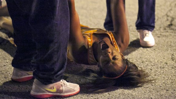 A woman is overcome with emotion near the scene of the shooting at Cornell Square Park in Chicago's Back of the Yard neighborhood on September 19.