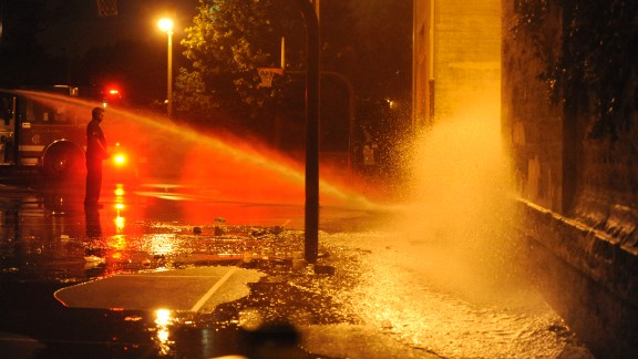 The Chicago Fire Department hoses down the scene where the shooting occurred.