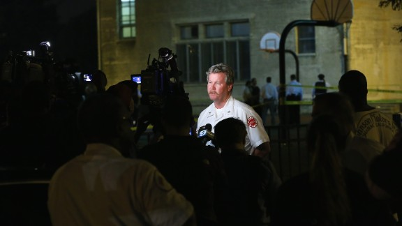 Deputy District Fire Chief James Mungovan updates the media after the shooting at Cornell Square Park on September 19.