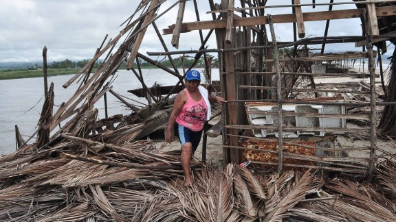 A resident of Barra de Coyuca checks the destruction in a restaurant by the beach in a tourist resort close to Acapulco, on Thursday, September 19.