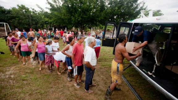 Villagers in San Jeronimo line up at a helicopter from Mexico