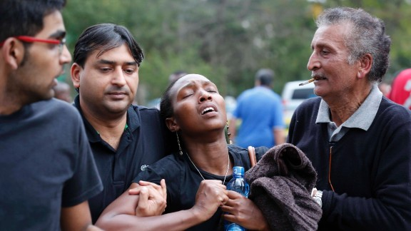 A woman reacts after she is rescued from the mall.