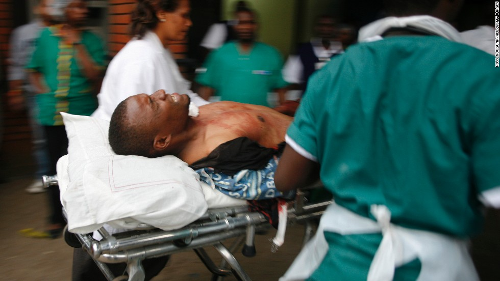 An injured man is wheeled into the Aga Khan Hospital in Nairobi.
