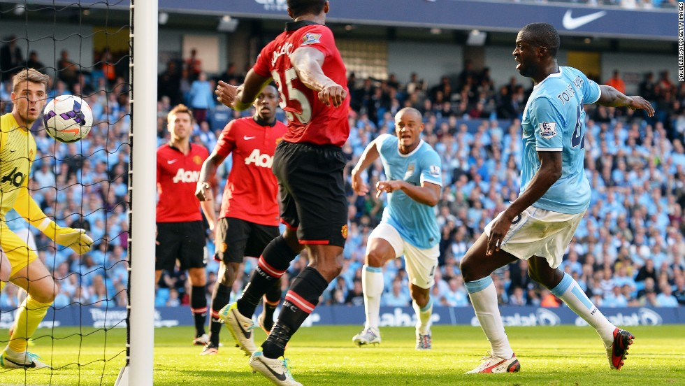 Yaya Toure (right) scored the crucial second goal in time added on to the first half, diverting Negredo's header into the net.