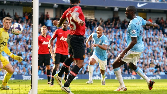 Yaya Toure (right) scored the crucial second goal in time added on to the first half, diverting Negredo