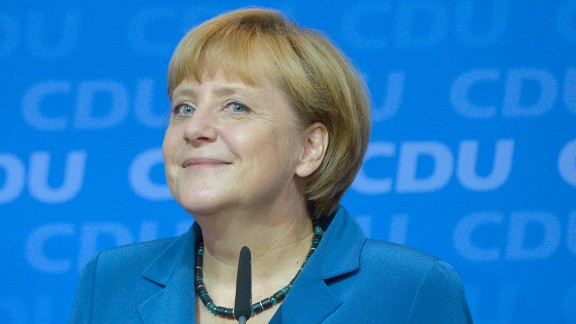 German Chancellor Angela Merkel reacts after the first exit polls in the country