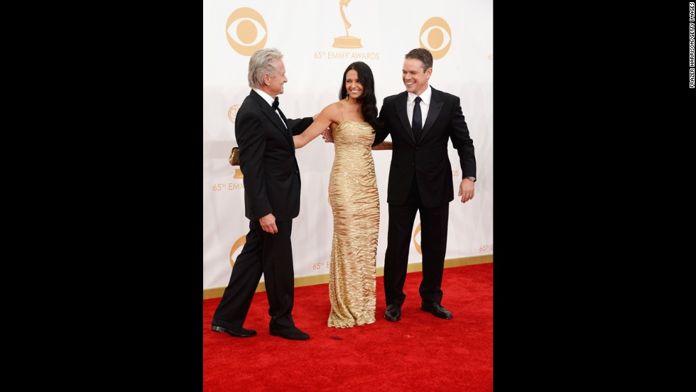 """Behind the Candelabra"" stars Michael Douglas, Matt Damon and Damon's wife, Luciana Barroso. The HBO biopic on Liberace won the Emmy for outstanding miniseries or TV movie, and Douglas received the top actor award in a miniseries or TV movie for his performance as the pianist."