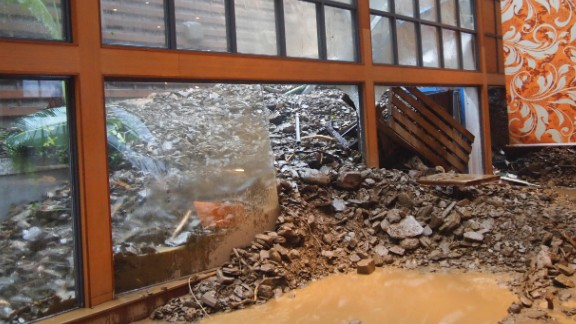 Typhoon Usagi's torrential rains caused landslides at a southern Taiwanese resort, sending mud and rocks crashing through the windows late Saturday, September 21.