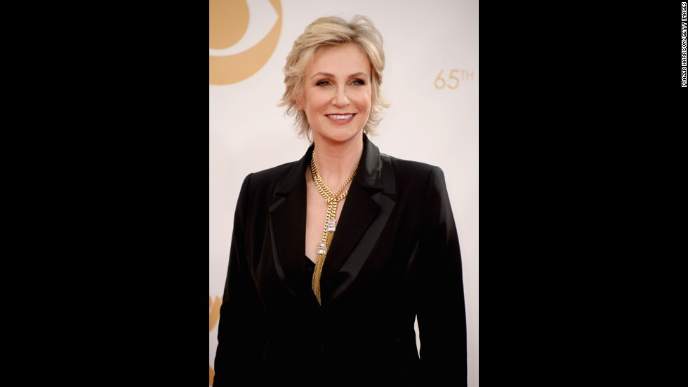 """Glee"" actress Jane Lynch wore several hats at the Emmys. In addition to being nominated for outstanding supporting actress in a comedy, Lynch also participated in the opening number and gave a tribute to the late Cory Monteith."