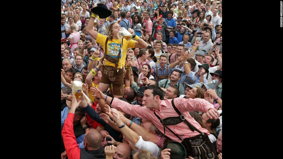People celebrate the opening ceremony of Oktoberfest.