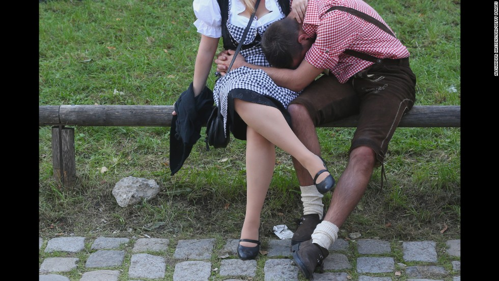 A man leans against a woman on Day One of Oktoberfest.