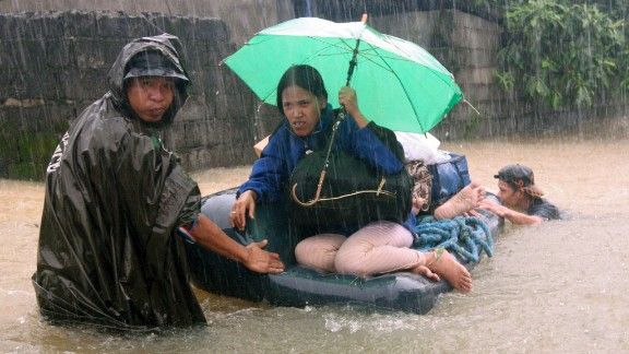 Soldiers rescue trapped residents northwest of Manila, Philippines, on September 23.